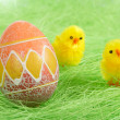 Chicks And Painted Colorful Easter Egg - Stock Photo