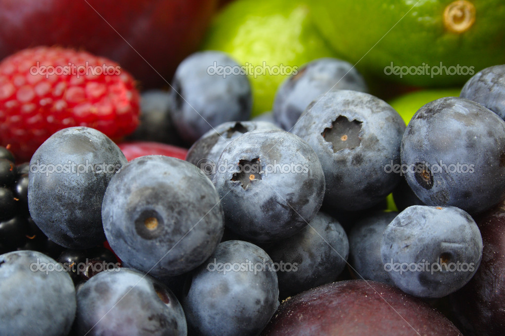 The berry on background of different fruit — Stock Photo #1909523