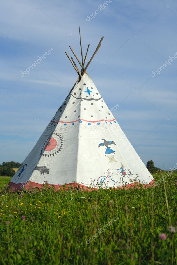  tipi on green meadow on background of blue sky  Stock Photo #1964684