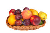 Fresh fruits in a basket — Stock Photo