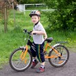 Boy on bicycle — Stock Photo