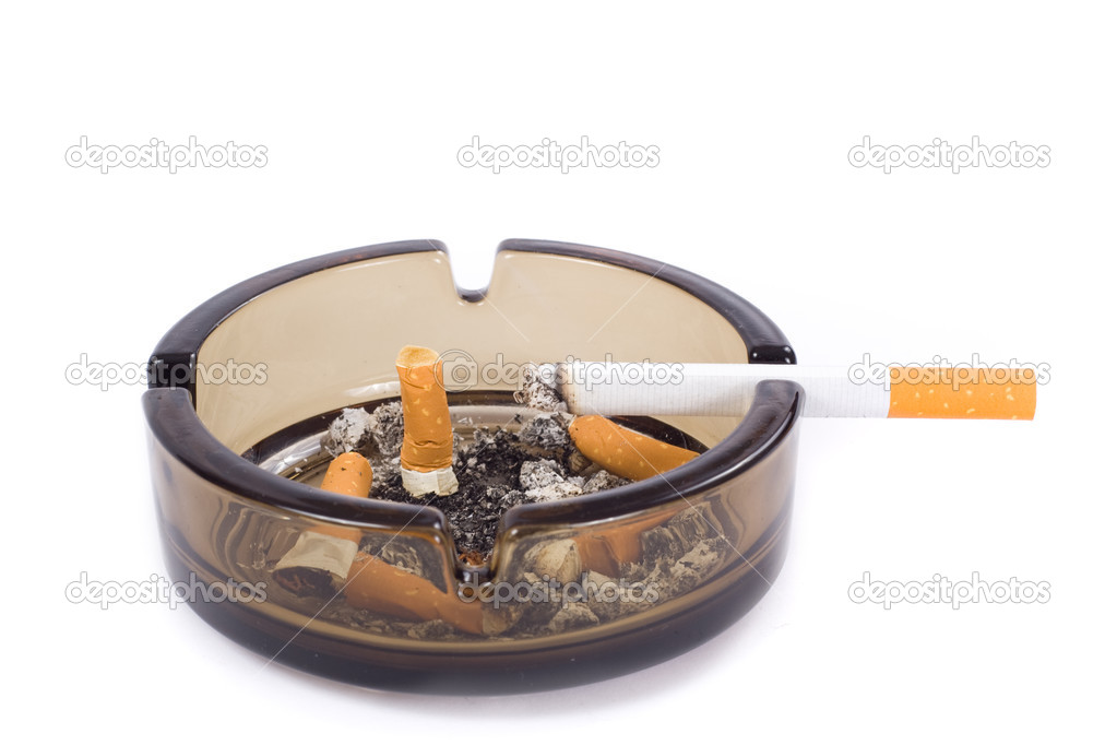 A flithy glass ash-tray, photo on the white background  Stock Photo #2620411