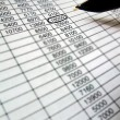 Spreadsheet, financial data analysis,pen — Stockfoto