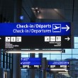 Airport gate sign, flight schedule - Stock Photo