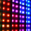 Photo: Colorful disco party lighting, abstract color background.