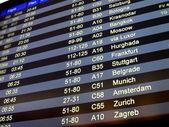 Airport delay sign, flight schedule — Stock Photo