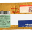 Single yellow mail package envelope - Stock Photo