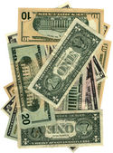 Pile of dollars isolated on white — Stock Photo