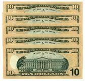 Heap of ten dollars isolated on white — Stock Photo