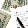 Money tax for W-9 Revenue Tax form - Foto Stock