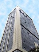 Real estate glass reflective skyscraper — Stock Photo