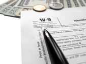 Filling the w9 Tax form by pen — Stock Photo