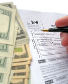 W-9 Revenue Tax form filling by pen — Stock Photo