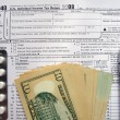Stock Photo: W-9 revenue tax form filling, black pen