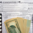 W-9 revenue tax form filling, black pen - Stock Photo