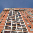 One urban high building, red brown brick — Stock Photo
