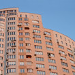 Stock Photo: New urbhigh red building, satellites,