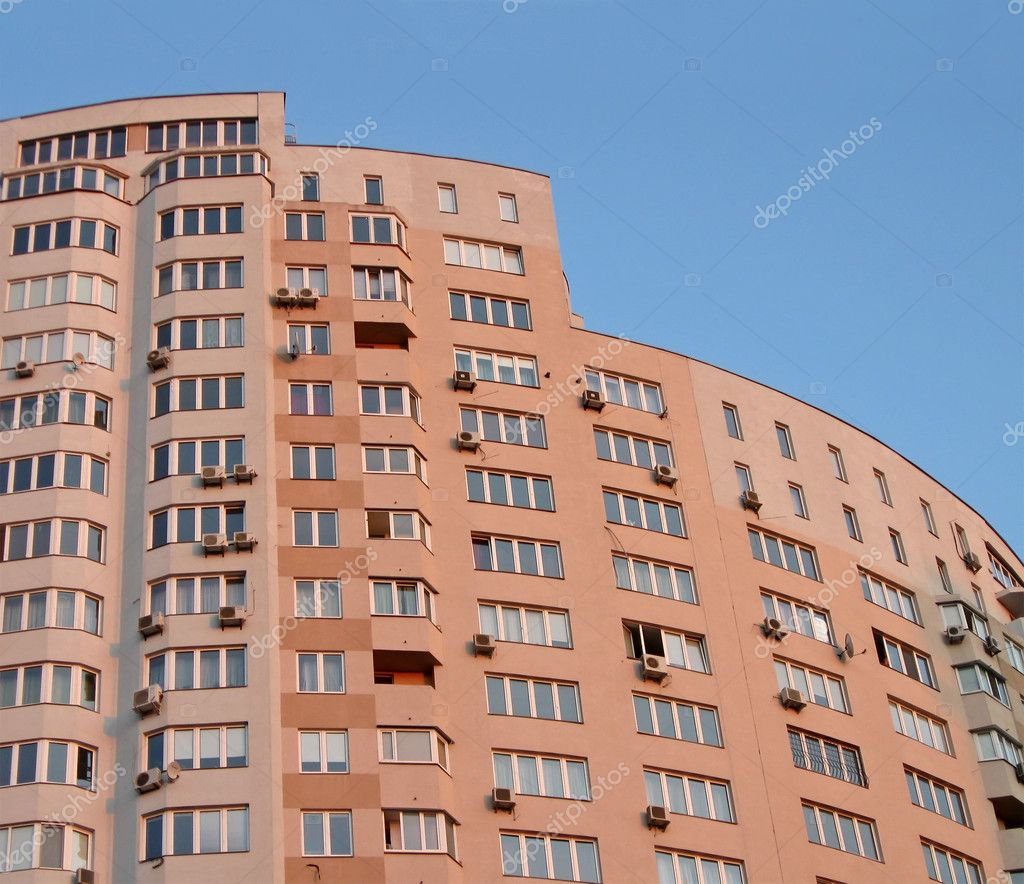 Outdoors view of new single high skyscrapper (red urban building with windows during sunset) . construction concept — Stock Photo #2097412