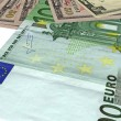Heap, different dollars, euros isolated — Stock Photo