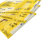 Few grunge yellow train tickets isolated — Stok fotoğraf
