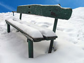 Vintage green wood bench, white snow — Stock Photo