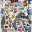 pile of different colorful post stamps — Stock Photo