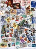 Pile of different colorful post stamps — Stok fotoğraf
