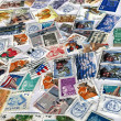 Heap of different colorful post stamps — Stock Photo #2517832