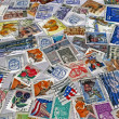 Royalty-Free Stock Photo: Heap of different colorful post stamps
