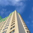 Stock Photo: New colorful green building, blue sky