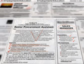 Newspaper headlines: advertising, jobs — Stock Photo