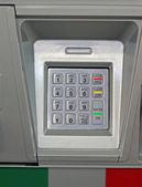 Metallic dial keypad, bank security — Stock Photo