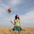 Girl with wind turbine at wheat field — Stock Photo #1869497