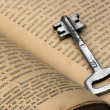 Key and book — Stock Photo