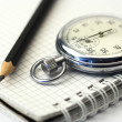 Stock Photo: Chronometer and pen
