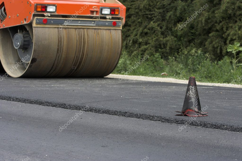 Traffic cone and road roller — Stock Photo #2117866