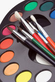Brushes and palette — Stock Photo