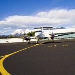 Small airplane on runway — Stock Photo