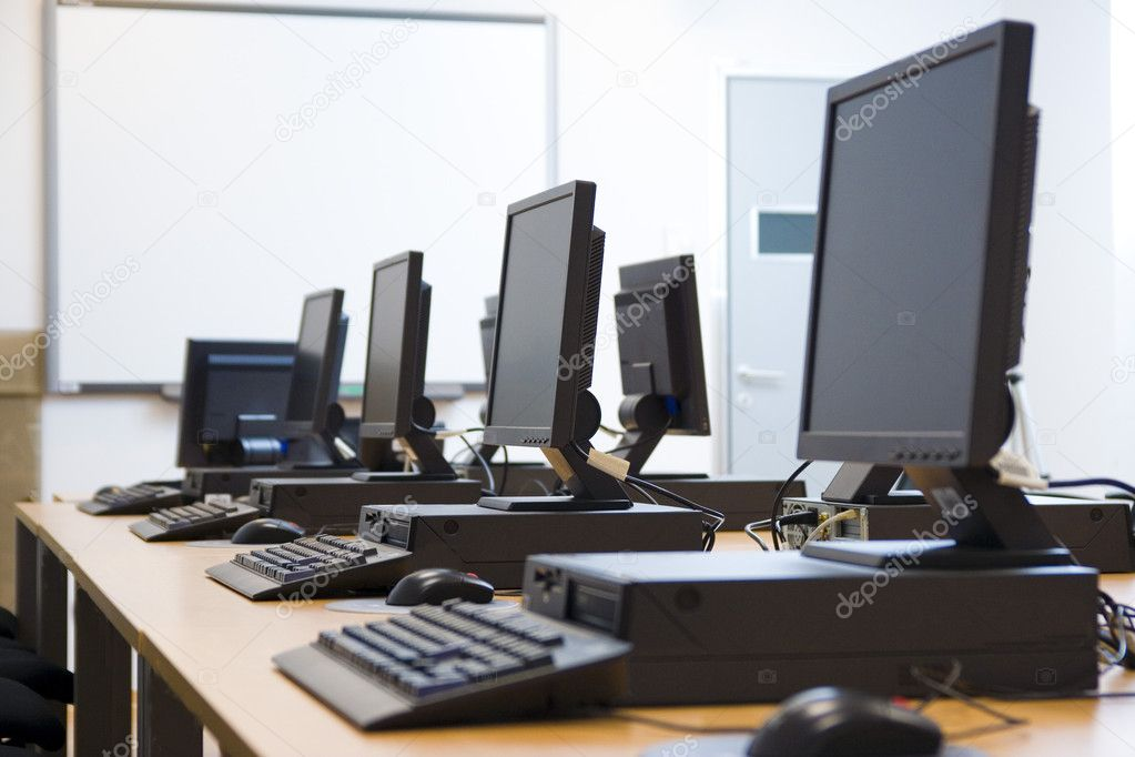 Room equipped with black computers and chairs. — Stock Photo #1917260