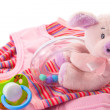 Baby's clothes and toys — Stock Photo