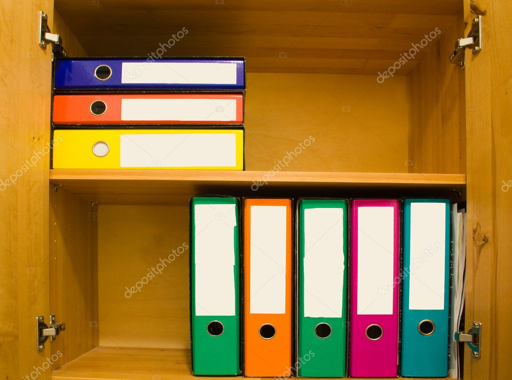 Colorful files with blank label in closet. — Stock Photo #1924527