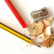 Pencils and a sharpener. - Stock Photo