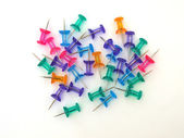 Multicoloured thumbtacks — Stock Photo