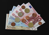 Euro notes and coins. — Stock Photo