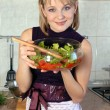 Housewife with salad — Stock Photo #2031225