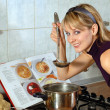 Young housewife cooking — Stock Photo #2031375