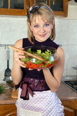 Housewife with a salad — Stock Photo