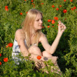 Girl on poppies field — Stock Photo #2416980