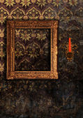 Gold wooden frame and candlestick — ストック写真