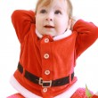 Little girl in red santa's clothes — Stock Photo